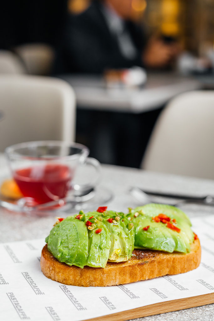 Baked country bread with fresh avocado, chilli